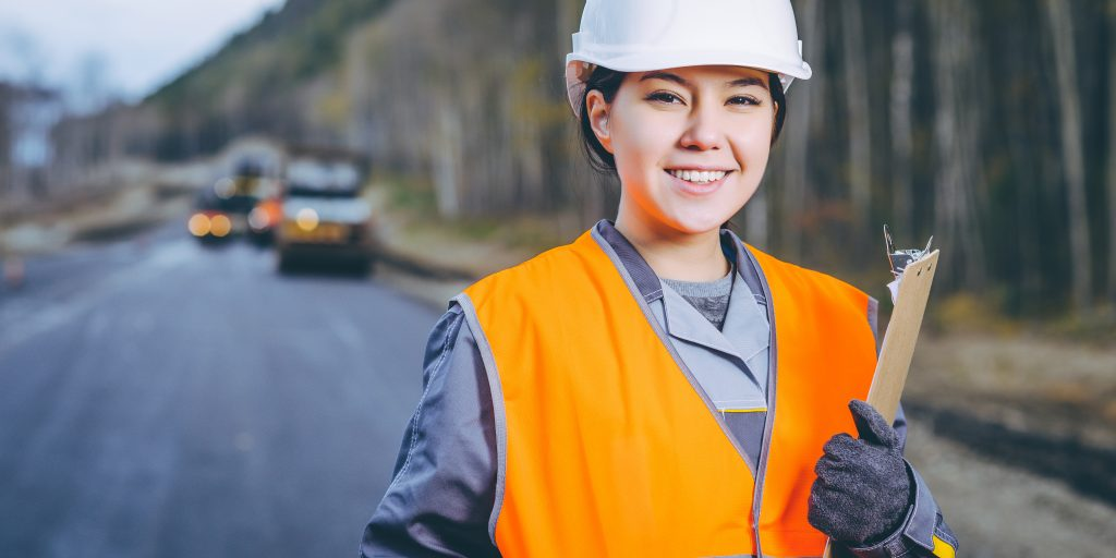 Young female working on road construction