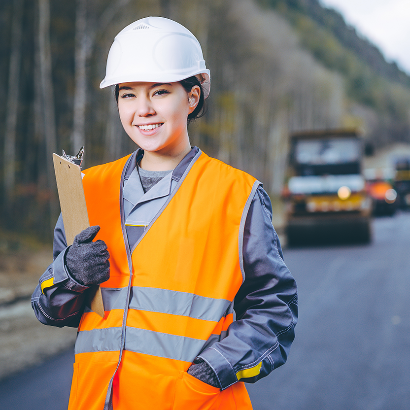female construction worker with hard hat on