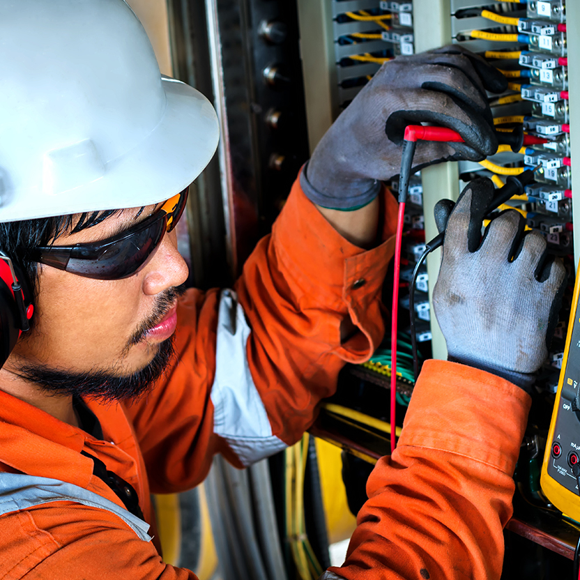 Technician working on a fuse box